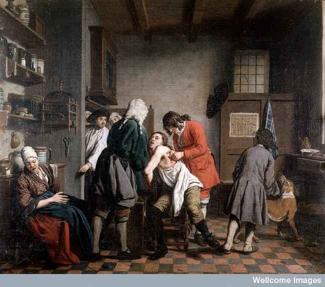 Interior with a surgeon attending to a wound in a man's side. Oil painting by Johan Joseph Horemans. ©Wellcome Images, Wellcome Library, London.